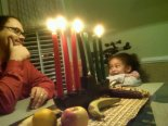 The author, Steven Allwood, with his daughter celebrating Kwanzaa