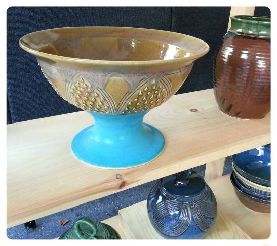 This fun pedestal bowl brings inviting colors right to your table. Great for hosting during a dinner party and a nice conversational piece with guest. By Carren Clarke-McAdoo of Woodland Height Studios.
