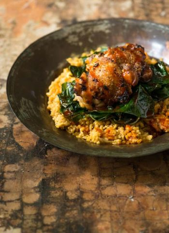 "Chicken Thighs with Red Palm and Coconut Rice from ""Senegal: Modern Senegalese Recipes from the Source to the Bowl"" by Pierre Thiam with Jennifer Sit. Photo Credit: © Evan Sung."